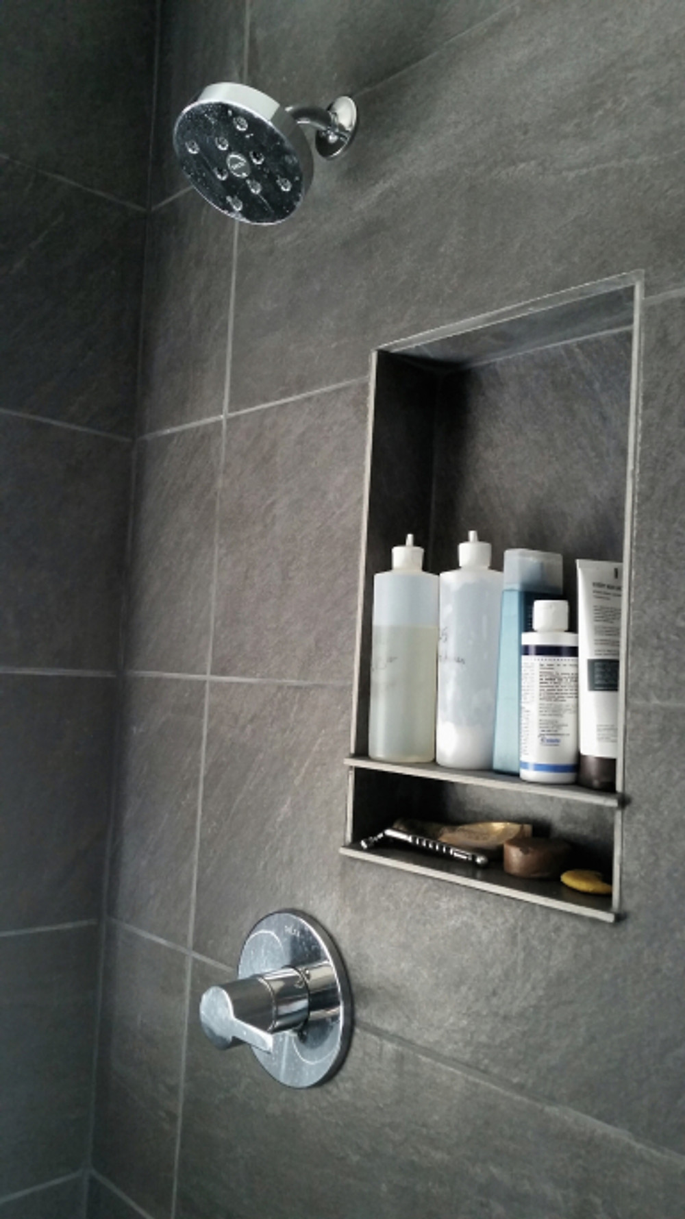 The new shower fixtures we love and the water flow is dreamy (and yet still energy efficient, yeah baybeeee!). Also had our GC carve out this cubby for our shampoo, etc. (mine are obviously the ones in the bulk bottles, not as pretty...), and a smaller one for the razor/soap. Love the little details! I almost had him do two but realized we're pretty simple and don't have a lot of stuff.