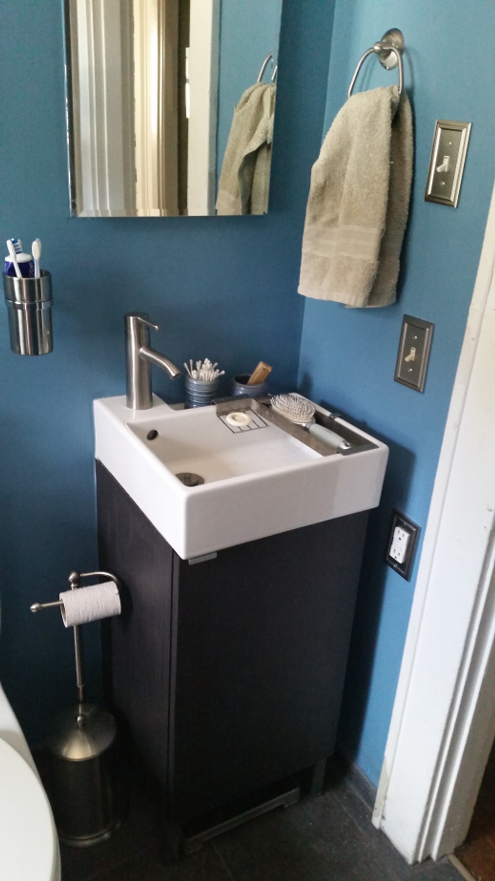 Our sink / medicine cabinet / etc. in more detail. I gotta say I was almost more excited about the toothbrush holder than anything LOL...