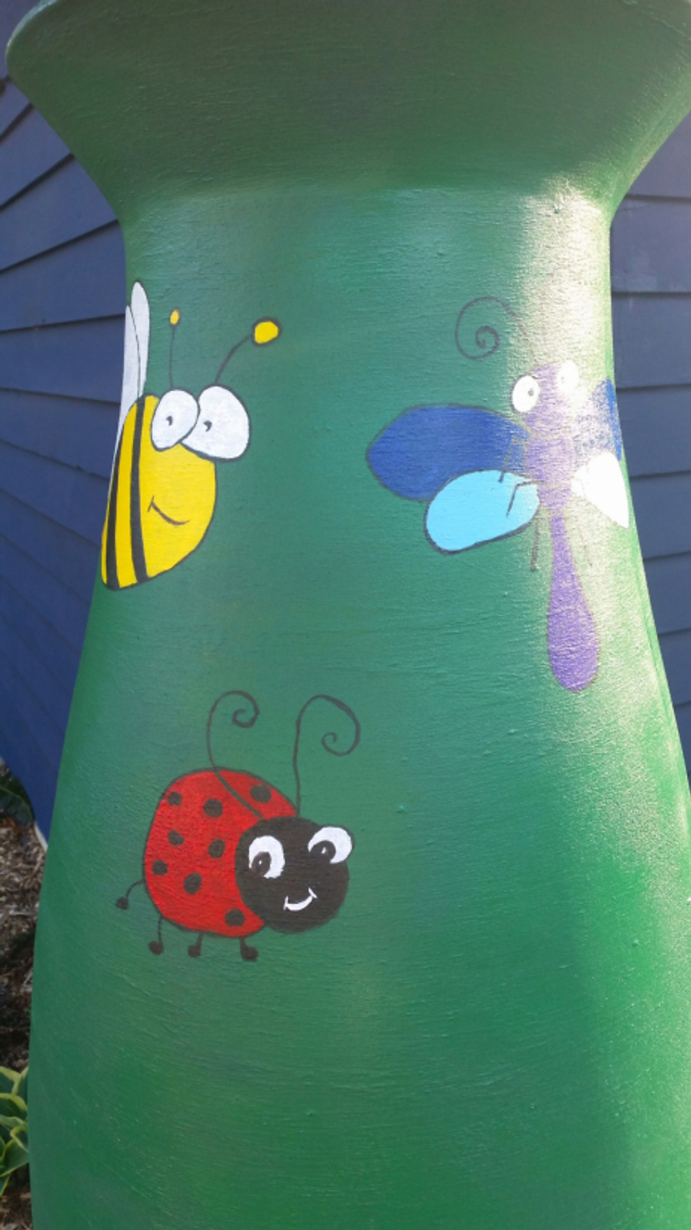 """Picked up some paint at Freddy's and started decorating the new rain barrel! Painted it green and we decided that """"good bugs"""" would be our theme (since the other ones have clouds and flowers). Found these ideas online and drew them freehand and then painted. Pretty cute eh?!"""