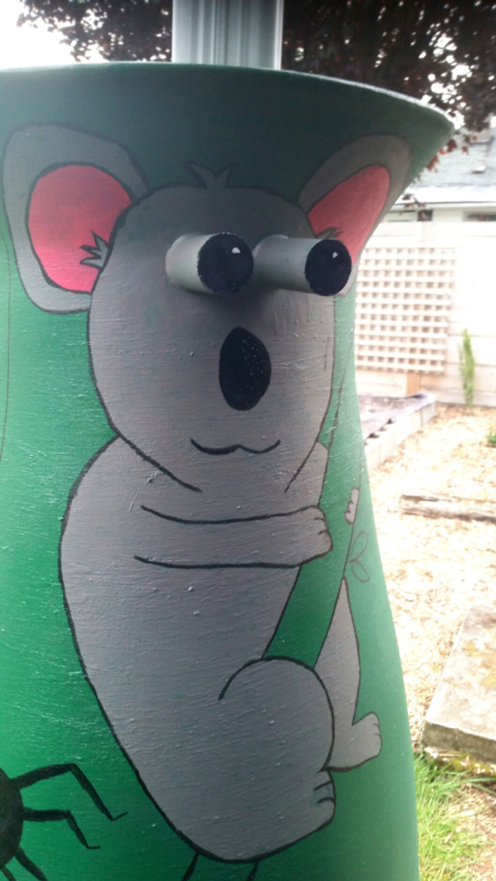 We decided to add some Aussie creatures to the rain barrel art as well so did this koala and also working on a kookaburra, kangaroo, and cockatoo :)