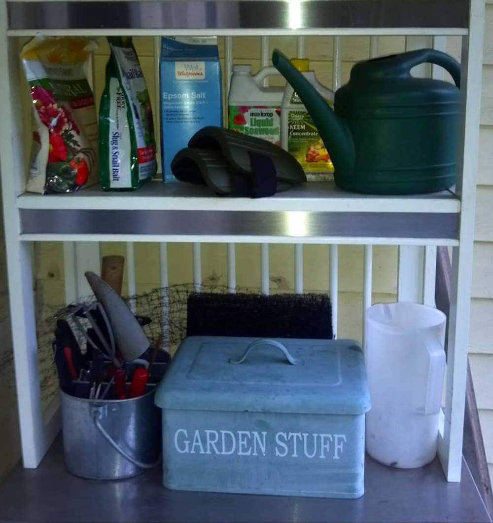 And during a rare moment of minimal precipitation, I got my garden shelves on the back porch all organized, woo hoo! Now to ponder the indoor seed-starting that is impending, hmm...