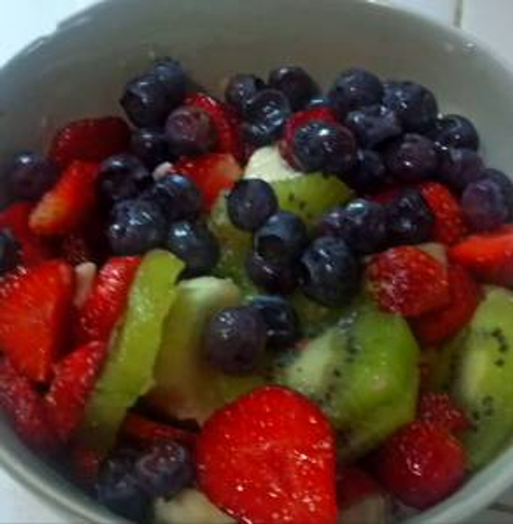 the nice thing about being gluten & dairy free? breakfast is about whole foods.  blueberries picked and frozen last summer by the quart, strawberries growing in my yard, and an organic kiwi and banana for good measure. happiness.
