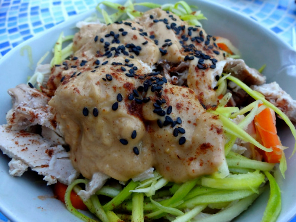 """I made chicken with tangy peanut sauce on zucchini """"noodles"""" - so perfect on a hot summer night!"""