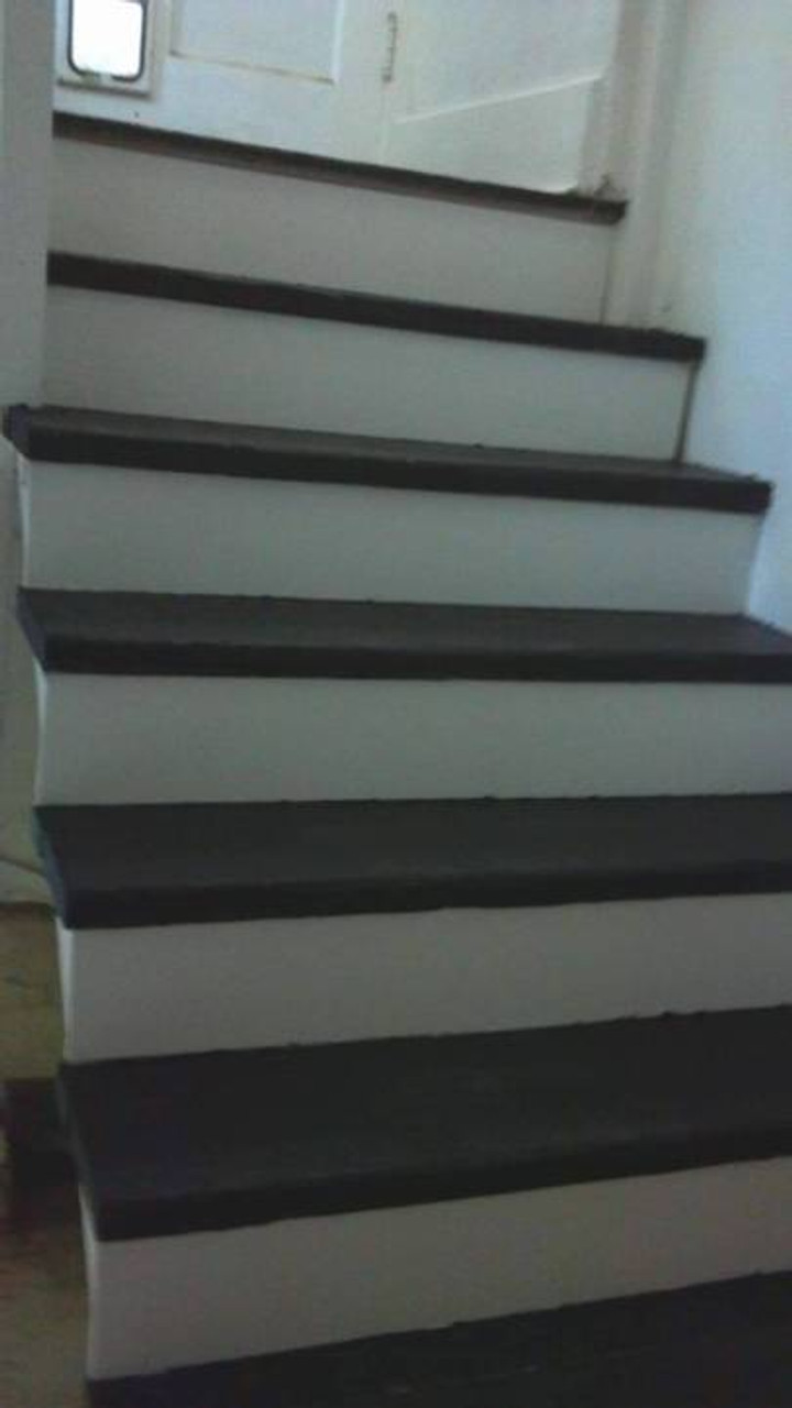 painted our dingy gray stairs black and white with the help of Rodda's zero-VOC Horizon paint.
