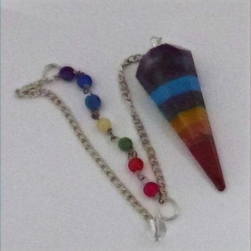 Pendule en pierre multicolore