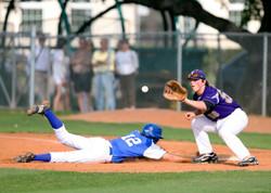 two-man-playing-baseball-during-daytime-