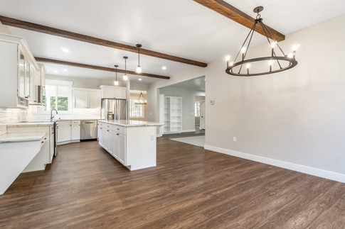 White Kitchen with Stained Beams