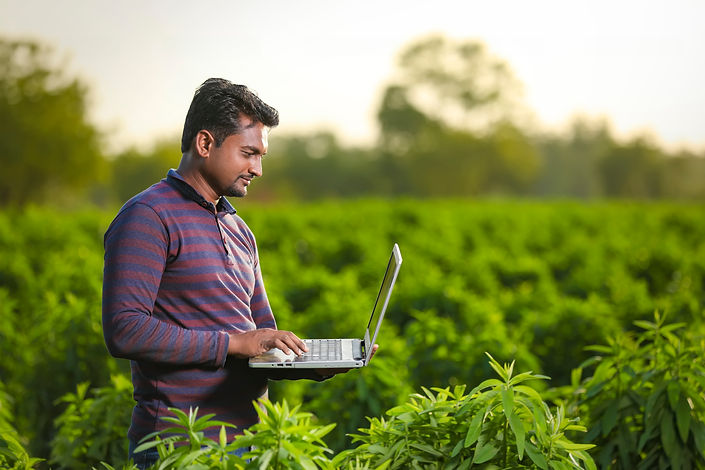 young-indian-farmer-with-laptop.jpg