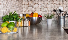 Kitchen counter top with metal bowls and canisters