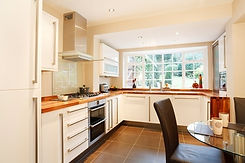 Clutter free cream and wood kitchen and dining table and chair