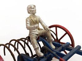 Driver sitting on a Britains Hay Rake 2.