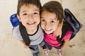 boy and girl with backpacks.jpg