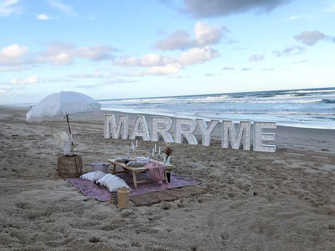 Light up 'MARRY ME' for a beach proposal at Surfers
