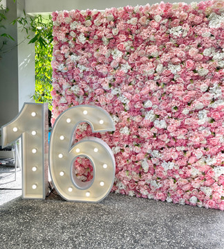 Light up 16 with our Pink and White Flower Wall