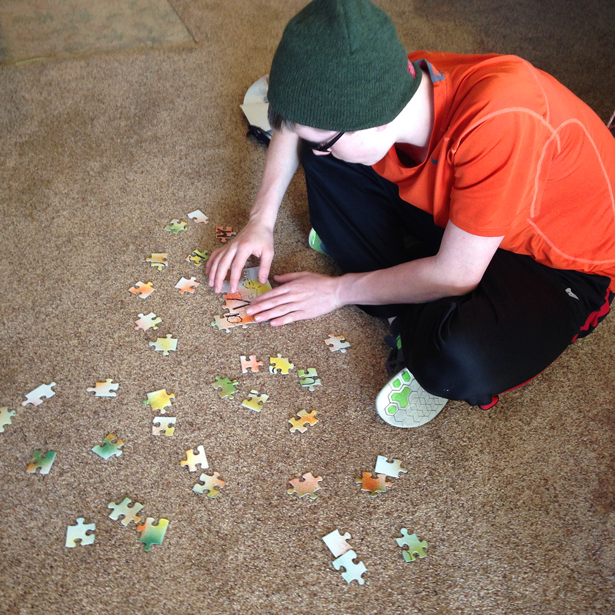 Evan putting his puzzle together
