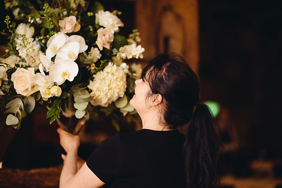 Louise Roots arranging a floral display