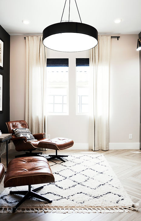 Bright living room with leather lounge chairs