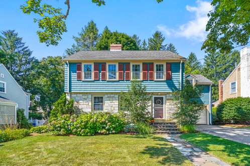 80 Sheffield Rd. | Melrose, MA SOLD: $950,000  4 Beds 2 Full | 1 Half Baths 2,424 Sq. Ft.  Quintessential East Side Colonial offers the right spaces, scale, updates, and features classic details: rounded doorways, molding, wood burning fireplace, paired china cabinets and a welcoming view from the hall to the lush yard. Nestled in a coveted neighborhood on a desirable street, this home allows you to entertain both inside and outside while offering secluded nooks for flex space needed today. Exuding the charm of its original era, LR and DR offer lovely original elements setting an elegant tone. EIK boasts a generous dining island, stainless appliances, including two ovens (a dual-fuel + a conv/micro), beverage fridge, and beautifully appointed backsplash, granite counters and lighting, while the sitting room opens to the deck and overlooks the flat yard.