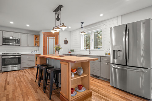 7 Abbot Rd. | N. Reading, MA SOLD: $755,000  3 Beds 2 Full | 1 Half Baths 2,491 Sq. Ft.  Completely transformed and enhanced over the last couple of years, this 7-room expanded Colonial offers many of the benefits of new construction in an established neighborhood. If you are looking to trade up this home has all the elements you've been missing. Lovingly renovated with all the modern touches, the builder added fine-crafted natural woodwork to create a warmer home. Open floor plan offers fantastic flex space. Kitchen is on-trend with a mix of gray and natural cabinets, some with open shelving. Note the custom butcher block prep/dining island.