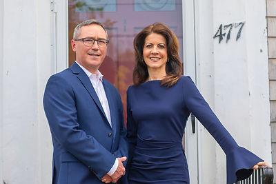 Del & Mary in front or office door
