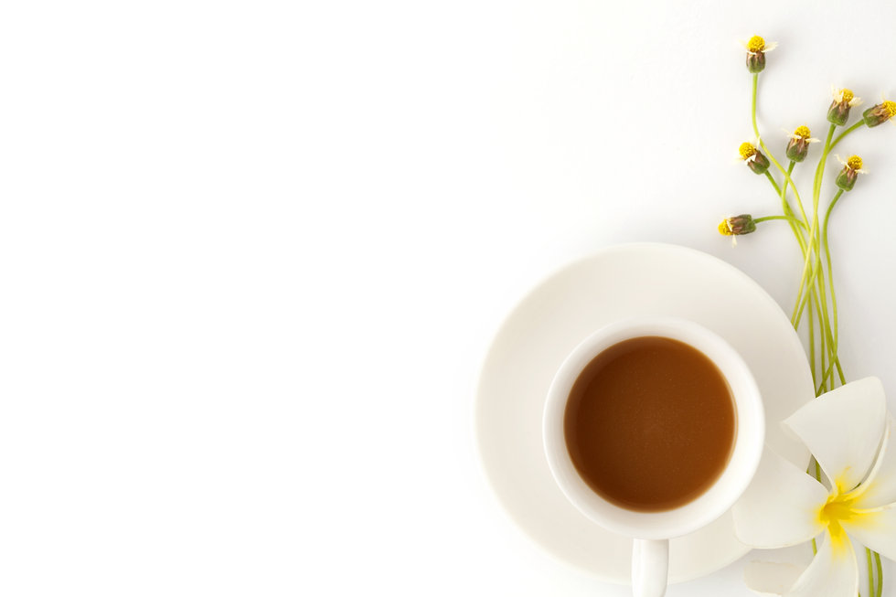 coffee with flower on white office table, for use on Web Design by Dena Testa Bray, LLC