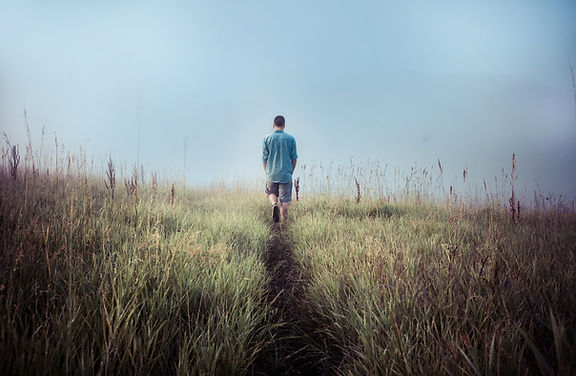 Man Walking in Fields