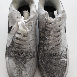 Smoke damged and stained trainers