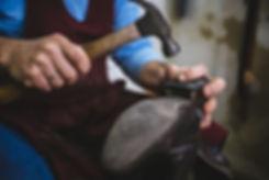 cobbler images repairing shoe heel.jpg