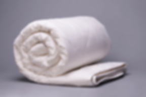 Washable-Wool-Comforter-Rolled.png