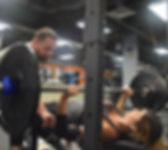 Woman bench pressing at NY Strong