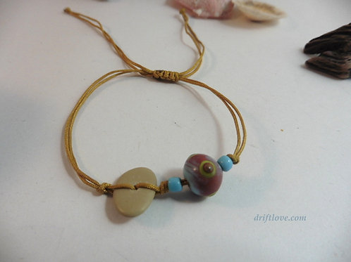 Golden Bracelet with Glass Beads and Pebble
