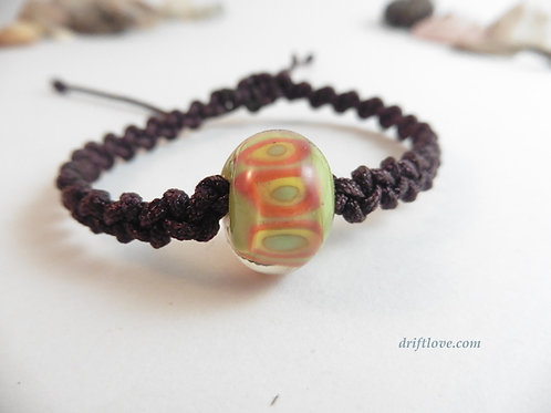Green-orange glass bead bracelet