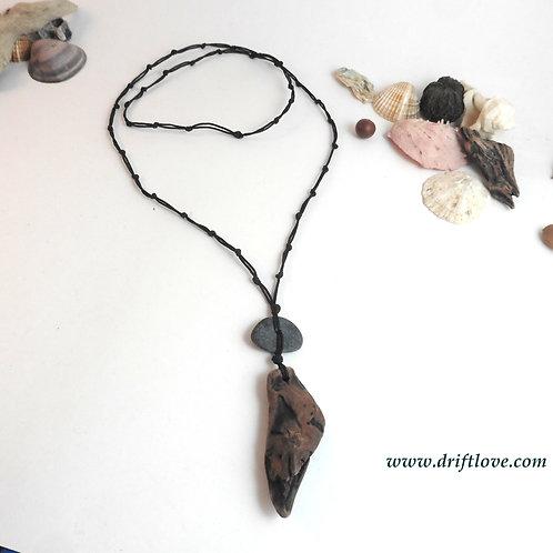 Black Pebble And Driftwood Amulet