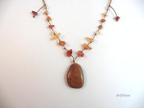 Red Pebble with Carnelian stones