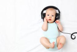 funny baby little boy in headphones.jpg