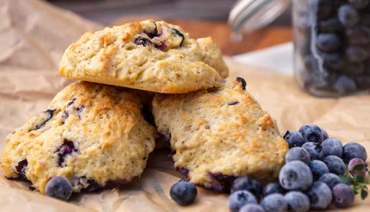 Flaky, buttery and tender, lemon blueberry scones come together in a snap! www.healthnutnation.com
