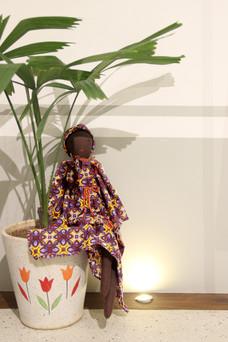puppet 7  next to a planter