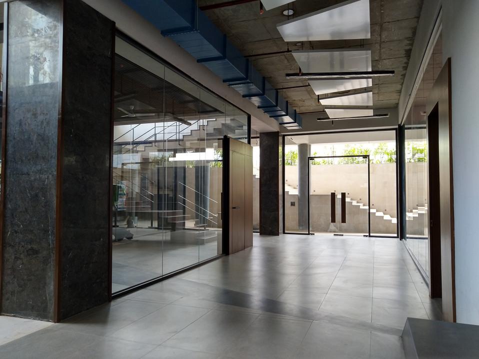 Basement corridor bringing in li