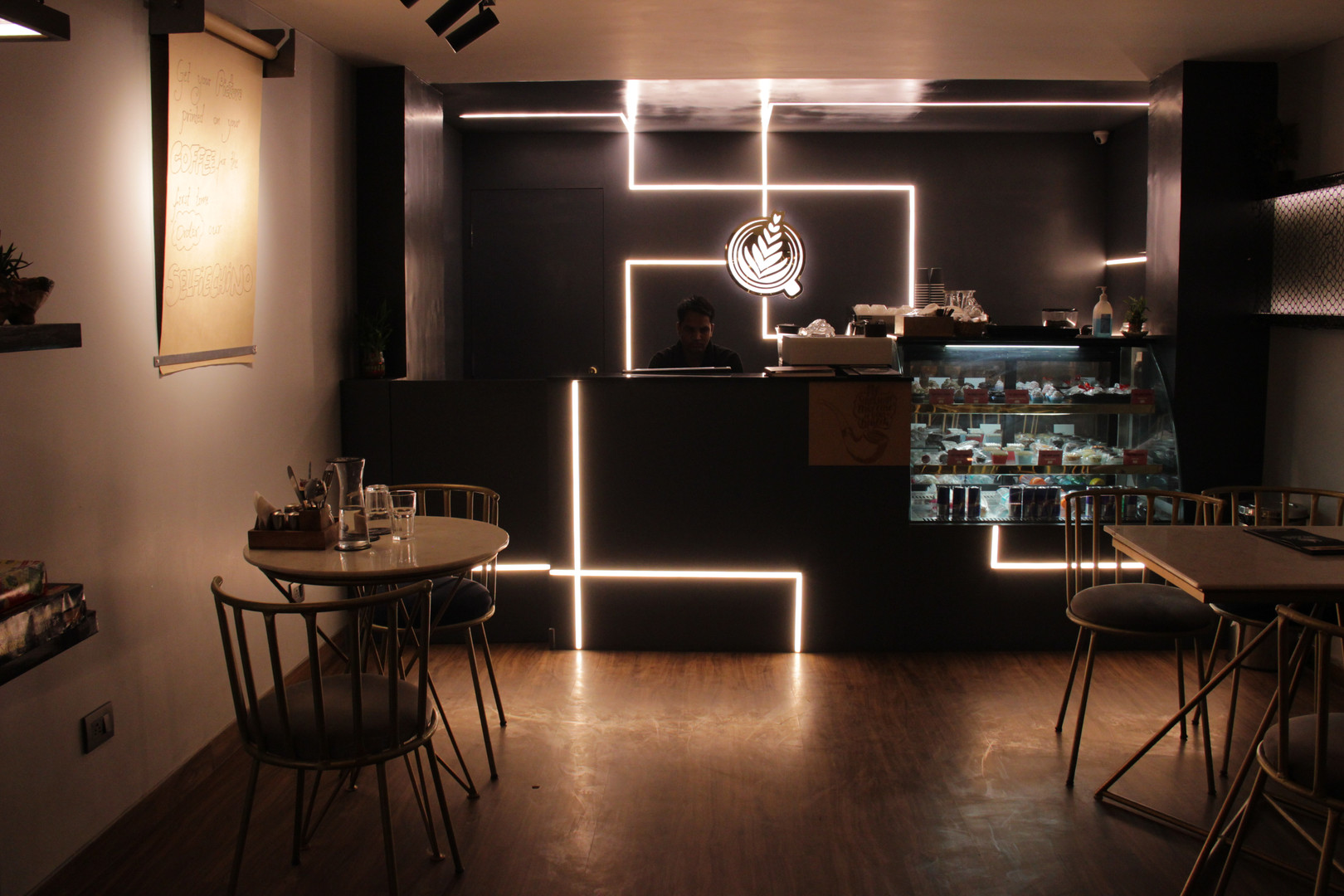 logo and menu graphics embeded in wall with lights