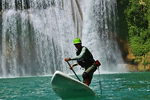 stand up paddle waterfall scene
