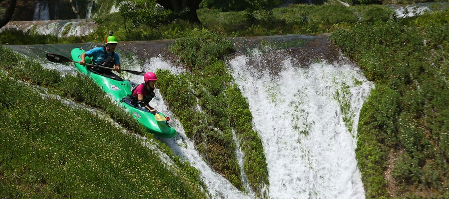 double kayak on a waterfall