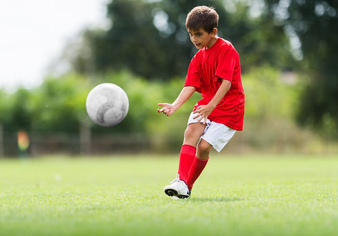 Little Boy Shooting at Goal.jpg