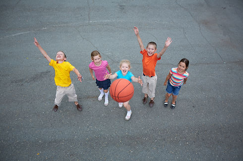Image of happy friends playing basketbal