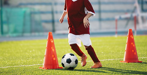Youth soccer practice drills with cones.