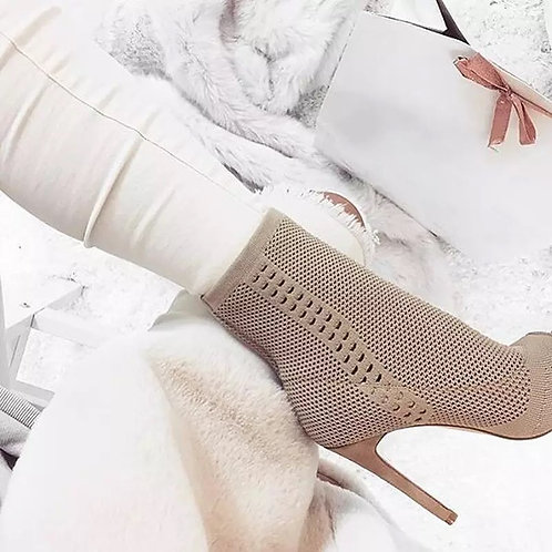 This stretch knit sock bootie features an on-trend peep toe and is elevated by a