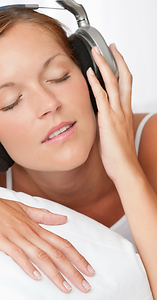Woman listening to a Subliminal Recording