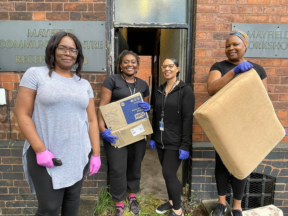 Four women from Walsall Black Sisters Collective and Walsall Police taking part in a 'clear out'.