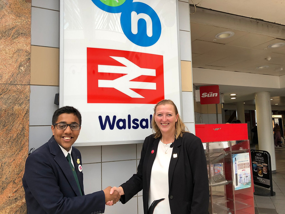 Kamran with Gill Ogilvie outside Walsall Train Station in the town centre.