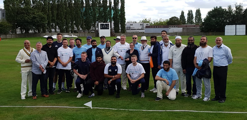 A large group of Walsall residents at Walsall Cricket Club posing for a photo