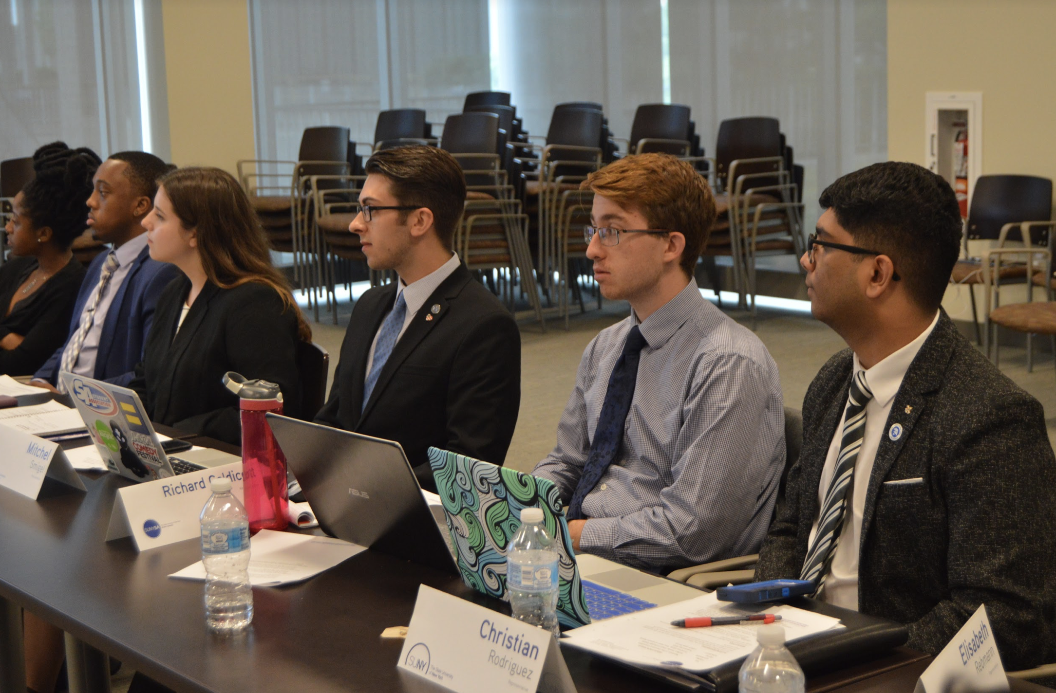 SUNY SA Representatives listening to a proposal during the business meeting at the University at Albany